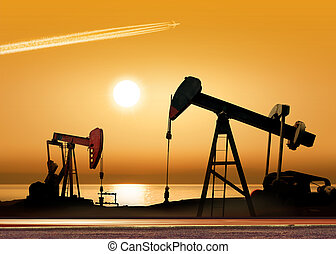 Working oil pumps - Working oil pump in rural place at...