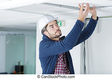 working on a ceiling