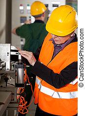 Working on factory machine