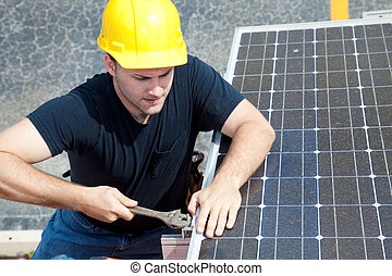 Working on Solar Panel - Green job series - young...