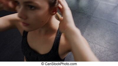 High angle view of a Caucasian woman wearing sports clothes at a sports centre gym working out doing sit ups