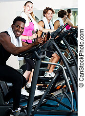 Working out gets easier, if done with friends. - Young group...