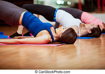 Working out in a gym class - Group of Hispanic women doing...