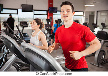 Working out on a treadmill at the gym
