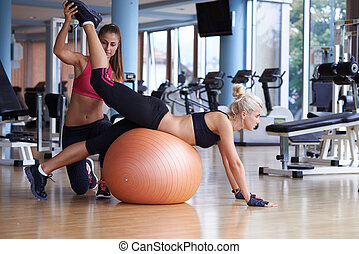 working out with personal trainer - woman exercise and...