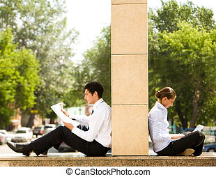 Working outside - Image of two business partners sitting ...