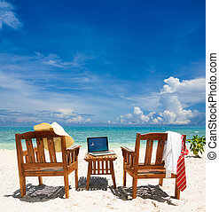 Working paradise - Chairs, laptop and put away tie and white...