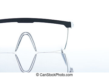 Working protective glasses close-up isolated on white...