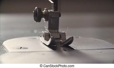 Working sewing machine - Macro shooting of a working sewing...