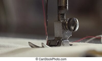 Working sewing machine - Slow motion macro shooting of a...