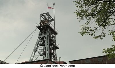 Working shaft of coal mine against steel sky