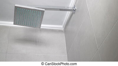 Working shower in the bathroom - Low angle shot of turning ...
