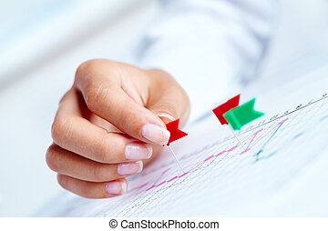 Working strategy - Close-up of female hand pricking on ...