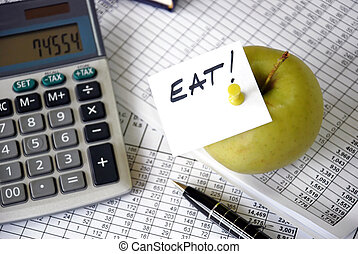 Working time planning - eat reminder on apple among papers...