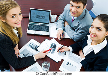 Working time - Portrait of three employees looking at camera...