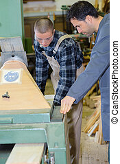working together in workshop with precision tools