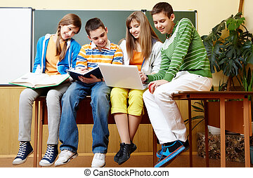 Working together - Portrait of clever students sitting in...