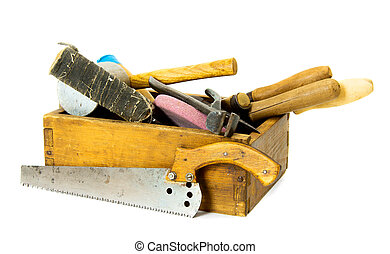 Working tools in an old box on white background.
