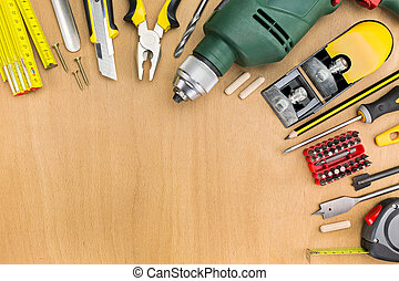 Working tools on wood background