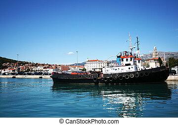 Working tug boat in port