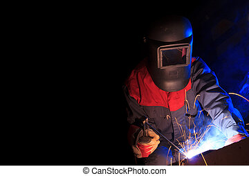Working welder on black background with copy space