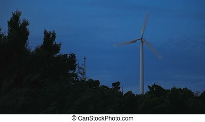 Working wind engine. Dusk at Windmill viewpoint. Phuket...