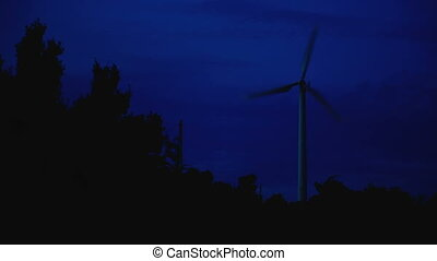 Working wind engine. Dusk at Windmill viewpoint. Phuket ...