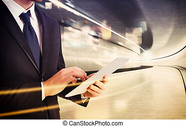 Working with a fast connection - Businessman work on tablet...