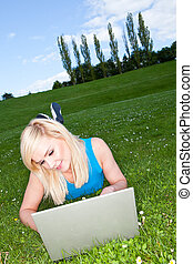 Working with a laptop in the park