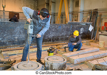 working with concrete in a warehouse