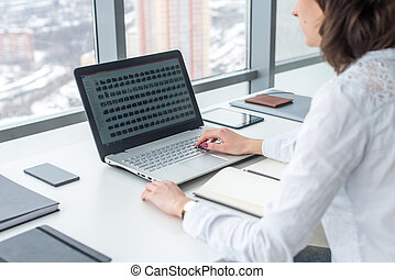 Working with laptop woman writing a blog. Female hands on the keyboard.