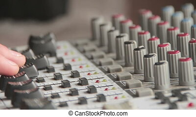Working with Sound Mixing Console - Sound engineer working...