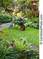 Working with wheelbarrow  in the garden