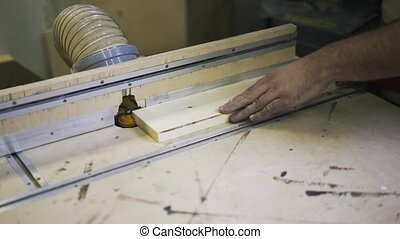 Working with wood using a special machine. Industrial tool.