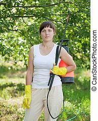 woman with garden spray