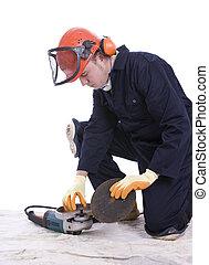workman changing blade on angle grinder