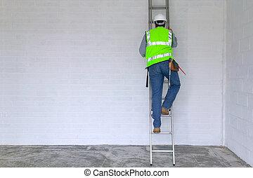 Workman climbing a ladder