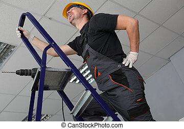 Workman having backache at job