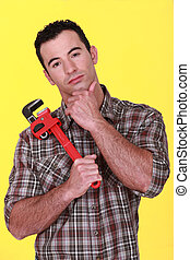Workman holding a pipe wrench