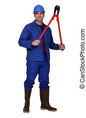 workman holding pliers