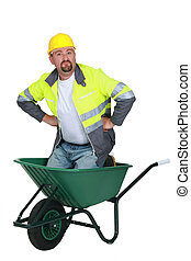 Workman in a wheelbarrow