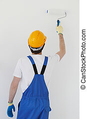 workman painting wall