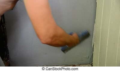 Workman plastering with a spatula wall - The workman ...