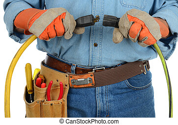 Workman Plugging in Extension Cords - Closeup of an...