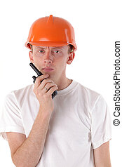 workman talking on portable UHF radio transceiver