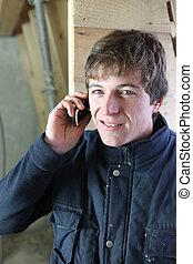 Workman using a cellphone