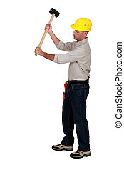 Workman using hammer, on white background