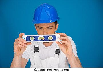 Workman viewing a spirit level