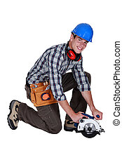 Workman with a circular saw