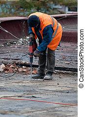 Workman with Jackhammer - Workman Using Jackhammer on Roof...